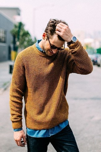 How to wear: black sunglasses, black jeans, blue denim shirt, mustard cable sweater