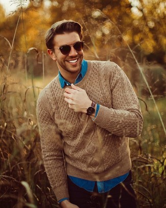How to wear: dark brown sunglasses, black jeans, blue denim shirt, brown cable sweater