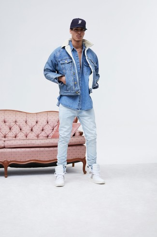 How to wear: white leather high top sneakers, light blue jeans, blue denim shirt, blue denim jacket