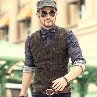How to wear: grey plaid flat cap, black jeans, navy camouflage denim shirt, olive wool waistcoat