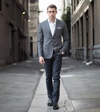 Men's Looks & Outfits: What To Wear In 2020: A grey blazer and navy jeans are among the unshakeable foundations of a functional wardrobe. To bring out a sophisticated side of you, introduce a pair of black leather oxford shoes to the mix.