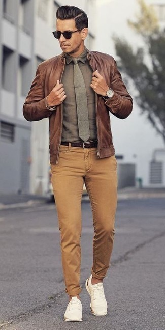 How to wear: white low top sneakers, khaki corduroy jeans, olive dress shirt, brown leather bomber jacket