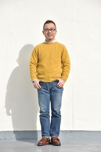 How to Wear a Mustard Crew-neck Sweater For Men: Wear a mustard crew-neck sweater and blue jeans for an everyday look that's full of charm and personality. A pair of brown leather desert boots finishes this getup very well.