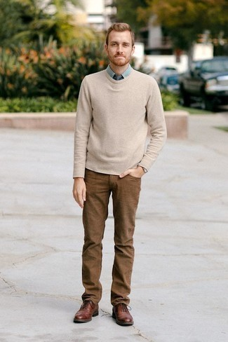 How to Wear Brown Leather Brogues: Want to infuse your menswear arsenal with some fashion-forward cool? Pair a beige crew-neck sweater with brown jeans. Brown leather brogues will infuse an extra touch of class into an otherwise all-too-common outfit.