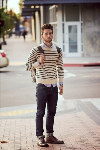 How to wear: dark brown leather desert boots, navy jeans, light violet dress shirt, beige horizontal striped crew-neck sweater