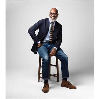 How To Wear a Double Breasted Blazer With Jeans For Men: Try teaming a double breasted blazer with jeans and get ready to get the status of a visionary in the men's fashion department. Want to go easy on the shoe front? Complement your getup with a pair of brown suede desert boots for the day.