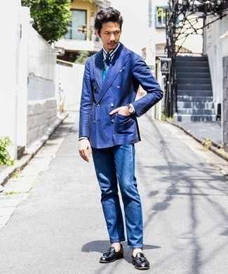 How to Wear a Double Breasted Blazer For Men: Opt for a double breasted blazer and blue jeans and you'll be the picture of masculine sophistication. Feeling transgressive today? Spice up your getup with a pair of black leather tassel loafers.