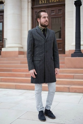 How to wear: navy suede desert boots, grey jeans, olive print dress shirt, charcoal overcoat