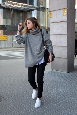 How to wear: white low top sneakers, black jeans, light blue vertical striped dress shirt, grey knit oversized sweater