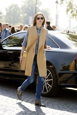How to wear: grey snake leather ankle boots, blue jeans, blue chambray dress shirt, camel sleeveless coat