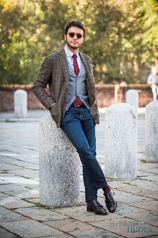 How to Wear Dark Brown Leather Double Monks: A grey sweater vest looks especially stylish when paired with navy jeans. Dark brown leather double monks will breathe a sense of class into an otherwise mostly dressed-down outfit.