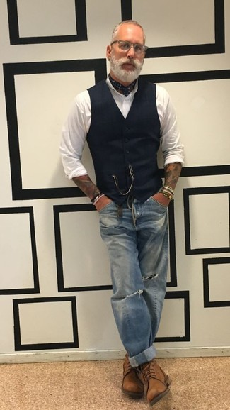 How to wear: brown leather casual boots, blue ripped jeans, white dress shirt, black waistcoat