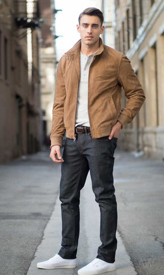 How to wear: white canvas low top sneakers, black jeans, beige henley shirt, brown suede bomber jacket