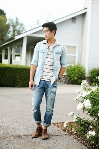 How to Wear Blue Ripped Jeans For Men: Opt for a light blue denim shirt and blue ripped jeans for an unexpectedly cool ensemble. For a dressier finish, complement this look with a pair of brown leather desert boots.