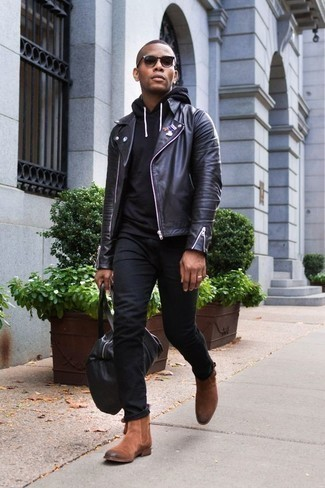 How to Wear a Black Leather Duffle Bag For Men: Rock a black leather biker jacket with a black leather duffle bag for a bold casual ensemble that's easy to throw together. To introduce a little classiness to this look, add a pair of brown suede chelsea boots to the mix. Men who are curious how to sport edgy off-duty style in your early 20s, you have your answer.