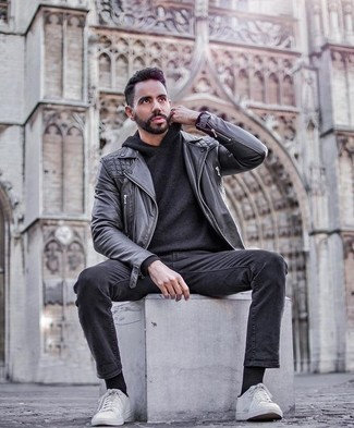 How to Wear Charcoal Jeans For Men: This laid-back pairing of a black leather biker jacket and charcoal jeans is capable of taking on different moods according to the way you style it. If you're puzzled as to how to finish, rock a pair of white canvas low top sneakers.