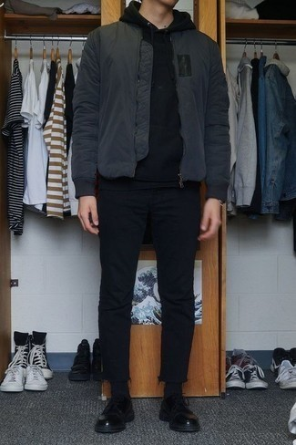 Men's Looks & Outfits: What To Wear In Fall: Who said you can't make a fashionable statement with a laid-back ensemble? Make ladies go weak in the knees in a charcoal bomber jacket and black jeans. To bring out a classy side of you, add a pair of black leather derby shoes to the equation. It's is an obvious choice if you're crafting a cool summer-to-fall ensemble.