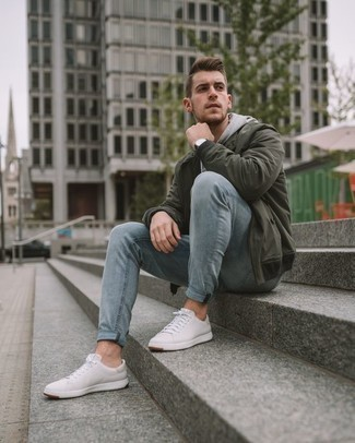 How to Wear White Leather Low Top Sneakers For Men: One of the coolest ways for a man to style out a dark green bomber jacket is to pair it with light blue jeans for a casual combination. As for shoes, complement this ensemble with a pair of white leather low top sneakers.