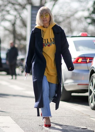 How to wear: red suede pumps, light blue jeans, yellow print hoodie, navy coat