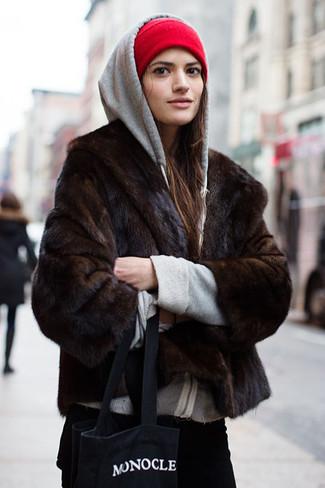 How to wear: black and white print canvas tote bag, black corduroy jeans, grey hoodie, dark brown fur jacket