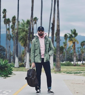 How to wear: black and white canvas low top sneakers, navy jeans, pink hoodie, green military jacket
