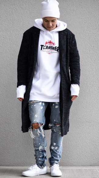 How to wear: white low top sneakers, light blue ripped jeans, white print hoodie, black overcoat