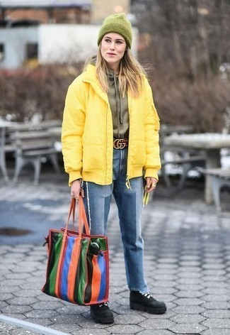 How to wear: black suede lace-up flat boots, blue jeans, olive hoodie, yellow puffer jacket