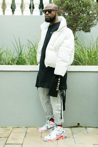 How to wear: white print leather high top sneakers, light blue jeans, black and white print hoodie, white puffer jacket