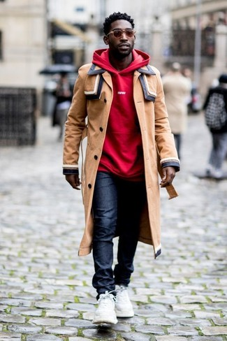 How to wear: white athletic shoes, navy jeans, red hoodie, tan trenchcoat