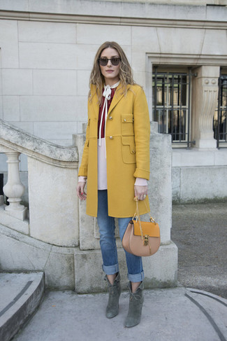 How to wear: dark green suede ankle boots, blue jeans, burgundy long sleeve blouse, mustard coat