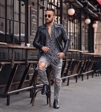 How to wear: black leather chelsea boots, grey ripped jeans, black and white print long sleeve shirt, black leather biker jacket