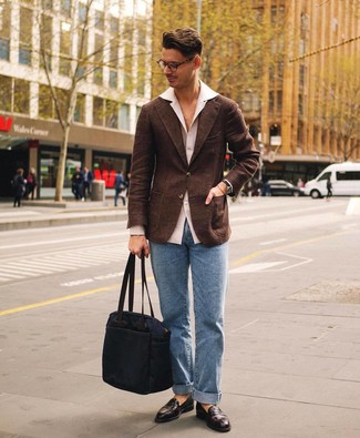 How to Wear a Dark Brown Wool Blazer For Men: Bump up your sartorial game by wearing this pairing of a dark brown wool blazer and light blue jeans. To add elegance to your ensemble, round off with dark brown leather loafers.