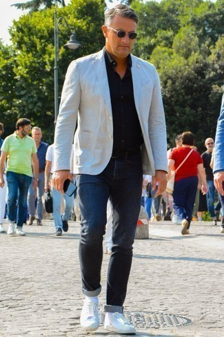 How to Wear a Black Long Sleeve Shirt For Men: This combination of a black long sleeve shirt and charcoal jeans is a safe and very stylish bet. A pair of white low top sneakers integrates well within plenty of combinations.