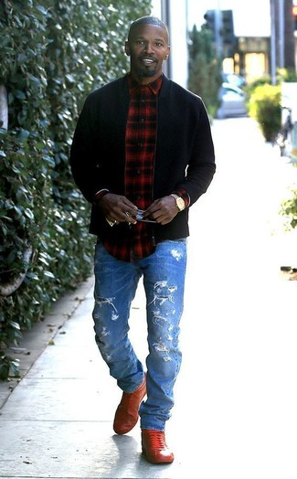 How to wear: red leather high top sneakers, blue ripped jeans, red and black plaid long sleeve shirt, black bomber jacket