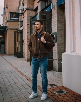How to Wear a Navy and White Polka Dot Long Sleeve Shirt For Men: Rock a navy and white polka dot long sleeve shirt with blue jeans to achieve an interesting and current relaxed ensemble. Opt for a pair of white low top sneakers and the whole outfit will come together.