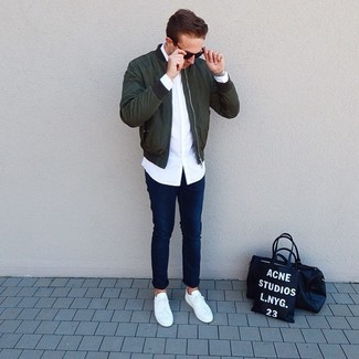 How to wear: white low top sneakers, navy jeans, white long sleeve shirt, dark green bomber jacket