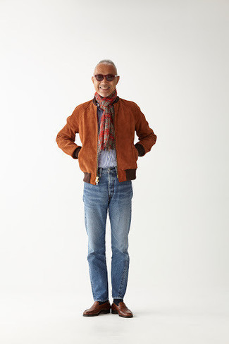 How to Wear a Tobacco Suede Bomber Jacket For Men: Consider teaming a tobacco suede bomber jacket with light blue jeans to achieve an interesting and current off-duty ensemble. For something more on the elegant side to finish off your outfit, add brown leather loafers to your ensemble.