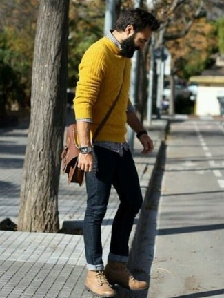 How to wear: tan leather work boots, black jeans, navy and white gingham long sleeve shirt, yellow cable sweater