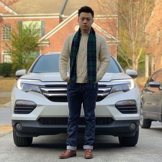 How to wear: brown leather derby shoes, navy jeans, light blue long sleeve shirt, beige cable sweater
