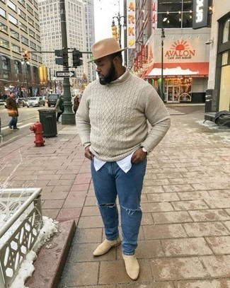 How to Wear Beige Suede Chelsea Boots In Your 30s For Men: On days when comfort is a must, this combination of a beige cable sweater and blue ripped jeans is always a winner. For something more on the classy end to complement your look, introduce beige suede chelsea boots to your getup.