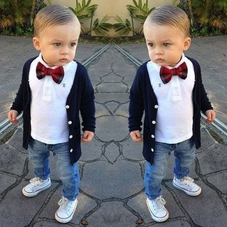 How to Wear a Navy Cardigan For Boys: Dress your child in a navy cardigan and blue jeans for a trendy and easy going look. As for footwear your little man will love white sneakers for this outfit.