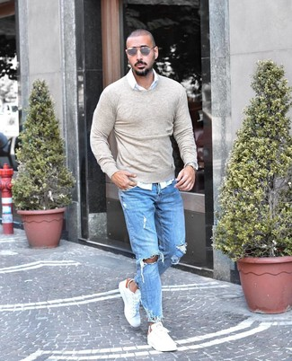 How to wear: white leather low top sneakers, light blue ripped jeans, white long sleeve shirt, beige crew-neck sweater
