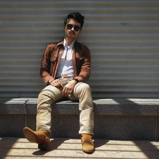 How to wear: tan suede cowboy boots, beige jeans, white long sleeve shirt, brown denim jacket