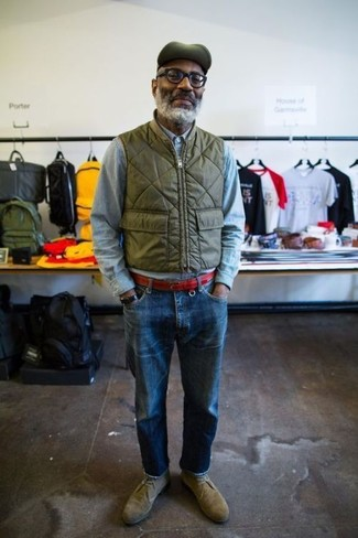 How to wear: olive suede desert boots, blue jeans, light blue chambray long sleeve shirt, olive gilet