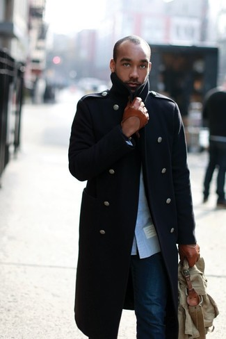 How to wear: olive canvas briefcase, navy jeans, blue long sleeve shirt, navy overcoat