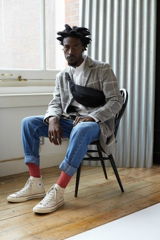 How to wear: white canvas high top sneakers, blue jeans, white long sleeve shirt, grey check overcoat