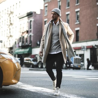 How to wear: white leather high top sneakers, black jeans, white long sleeve shirt, beige overcoat