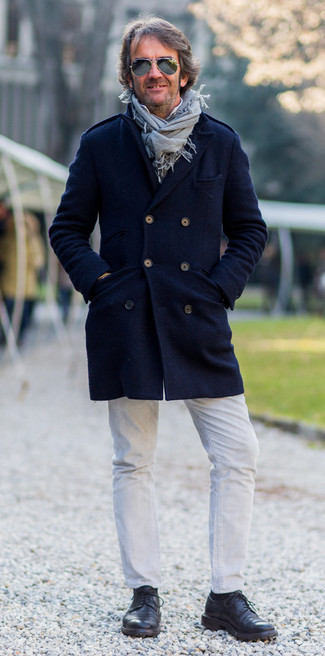 How to wear: black leather derby shoes, white jeans, white long sleeve shirt, navy overcoat