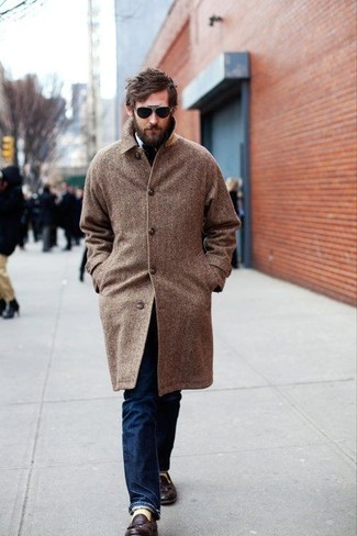 How to Wear Black Sunglasses For Men: Consider pairing a brown herringbone overcoat with black sunglasses for a casual street style ensemble that's easy to wear. Take this getup down a more elegant path by rounding off with dark brown leather tassel loafers.