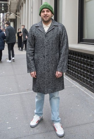 How to Wear a Grey Herringbone Overcoat: This pairing of a grey herringbone overcoat and light blue jeans is a real lifesaver when you need to look stylish but have zero time. Rounding off with a pair of white and red leather low top sneakers is an effortless way to add a more casual feel to your getup.
